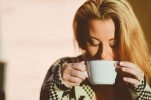 woman drinking from a mug
