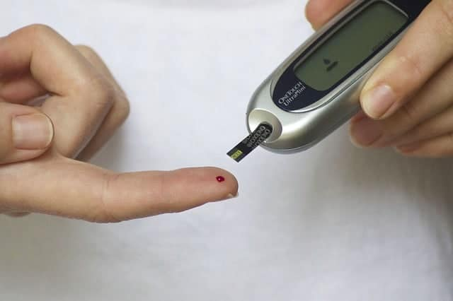 diabetic finger prick to check blood sugar levels