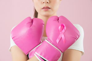 a woman wearing pink boxing gloves