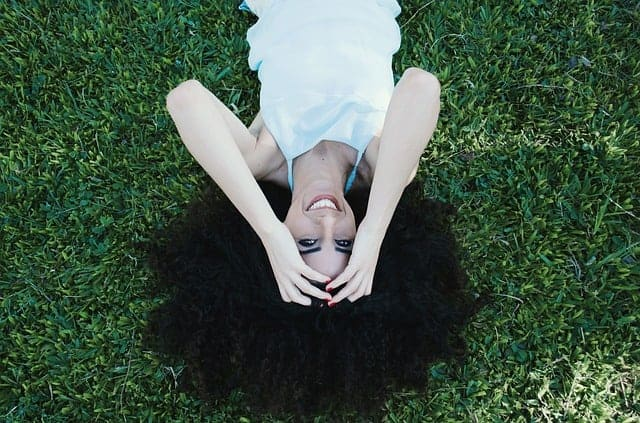 happy woman laying in the grass