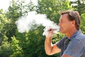 Man vaping or smoking with a CBD Vape Pen