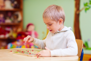 child playing with an educational board game