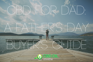 "Graphic lettering of ""CBD FOR DAD: A FATHER'S DAY BUYER'S GUIDE"" superimposed over an image of a father standing in the docks carrying a child"